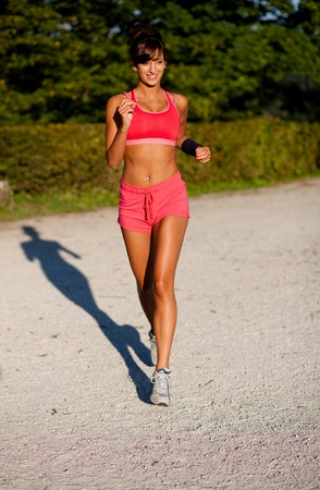 Beautiful fit young woman jogging in a park Stock Photo - 10128658