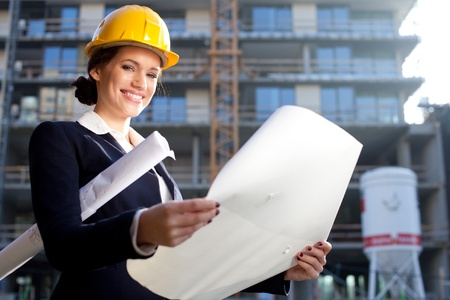 female engineer: Young female architectconstruction engineer at a construction site Stock Photo