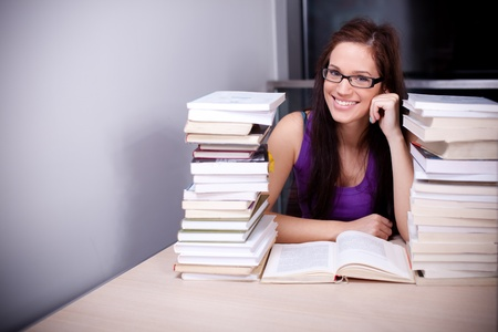 Beautiful female student studying hard in the library photo