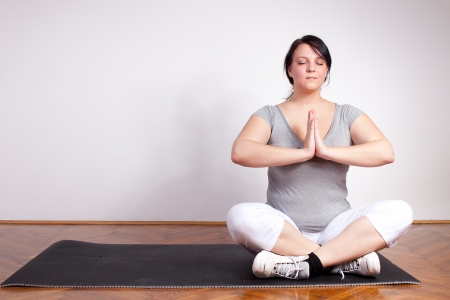 plus sized: Plus sized woman in a yoga position