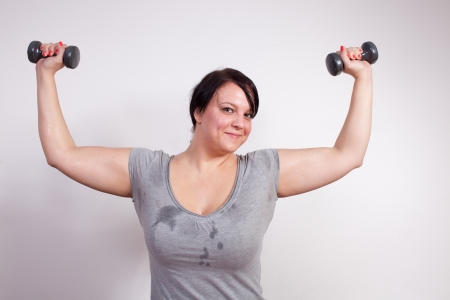 sweaty: Overweight woman exercising, lifting weights