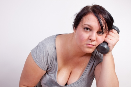 Sweaty overweight woman is fed up and tired of exercising Stock Photo - 12031500