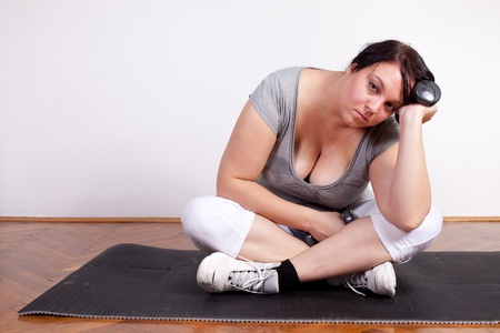 fed: Plus size woman is fed up and tired of exercising Stock Photo