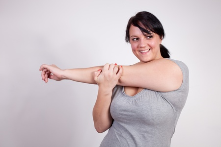 Size plus woman stretching  photo