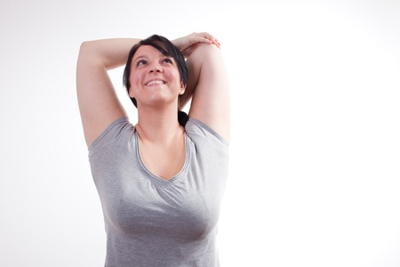Overweight woman exercisingstretching photo
