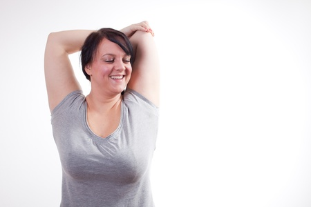 chubby girl: Happy overweight woman exercisingstretching
