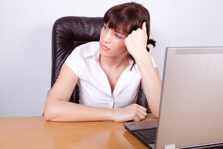Tired and bored young businesswoman in her office Stock Photo - 12163982