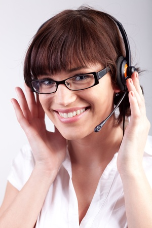 Portrait of a happy customer support employee  secretary photo