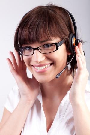 Portrait of a happy customer support employee  secretary photo