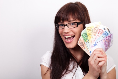 ecstatic: Ecstatic young woman with her hands full of money