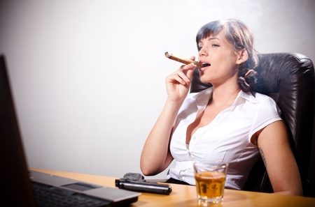 smoking girl: Young businesswoman relaxing in the office