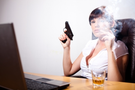 liquor girl: Young businesswoman smoking a cigar, with a gun in her hand