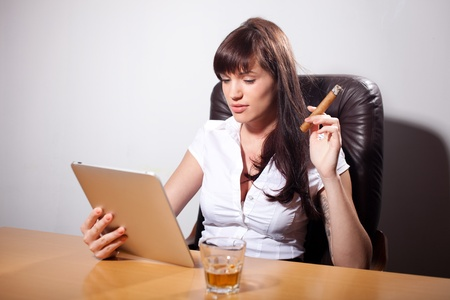cigar smoking woman: Young businesswoman enjoying her time in the office