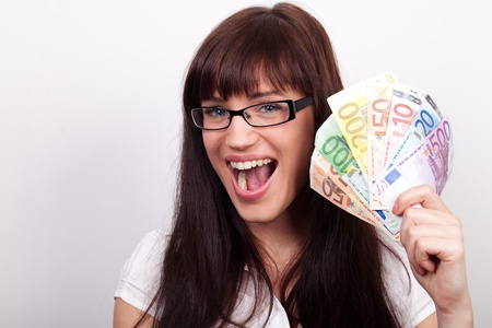 Happy young woman holding Euro bills photo
