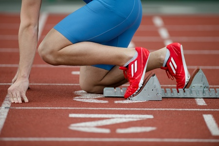 tenseness: Detailed view of a sprinter in the starting blocks Stock Photo