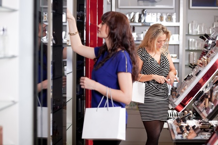 Women buying cosmetics in a beauty store photo