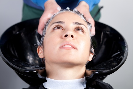 Young woman getting a hairwash in a hair salon. Selective focus. Stock Photo - 13295594