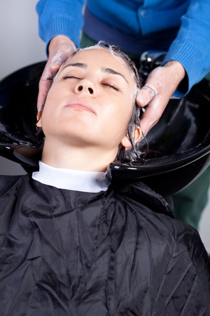 Woman getting a hairwash in a hair salon. Selective focus. photo