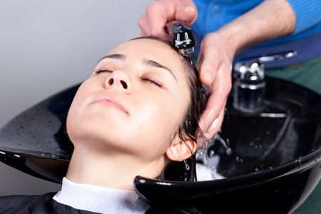 Haidresser washing woman's hair at a hair salon. Selective focus. Stock Photo - 13295597