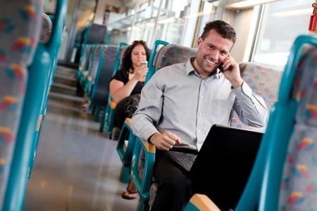 passenger buses: Apuesto hombre de negocios trabajando en el tren Foto de archivo