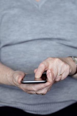 Senior woman using smartphone photo