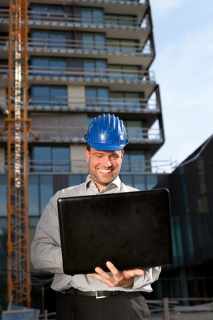 Happy construction engineer on construction site Stock Photo - 13551940