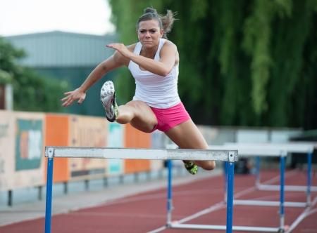 Professional female hurdler during training photo