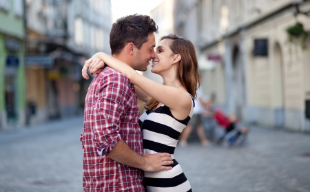 kissing couple: Young couple in love, hugging on the street. Selective focus. Stock Photo