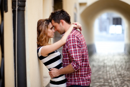 Young couple in love, hugging in the old part of town photo
