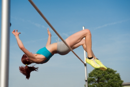 Female high jumper in action photo