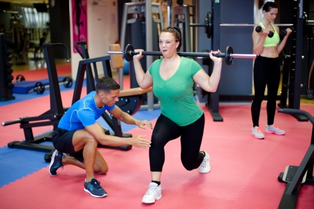 Plus size womans first training with personal trainer photo