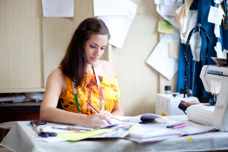 designer working: Authentic image of a fashion designer working in her studio