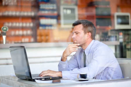 coffeeshop: Candid image of a pensive businessman in a cafe Stock Photo