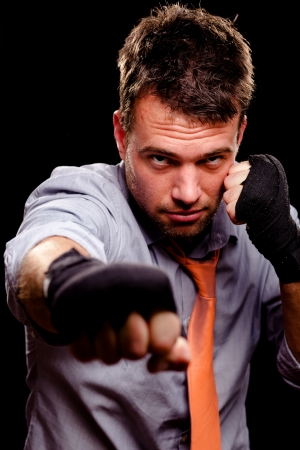jab: Boxing businessman throwing a jab  High contrast  Stock Photo