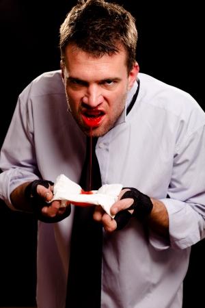 spitting: Businessman spitting blood