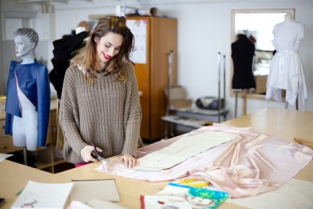 Fashion designer working in the studio photo