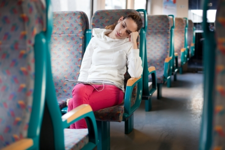public transportation: Young woman sleeping on the train