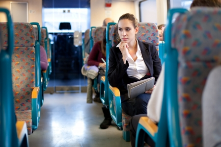 Pensive businesswoman on the train Stock Photo - 17744737
