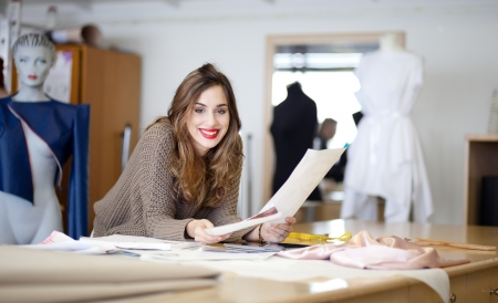 Fashion designer going through her sketches Stock Photo - 17822842
