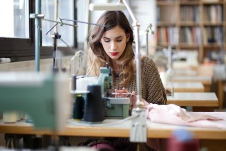 textile designer: Tailor sewing in workshop
