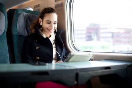 public transportation: Young woman traveling on the train in business class Stock Photo