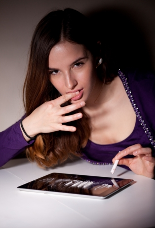 Young woman tasting cocaine photo