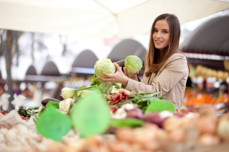 Woman buying vegetables at the market Stock Photo - 18914701