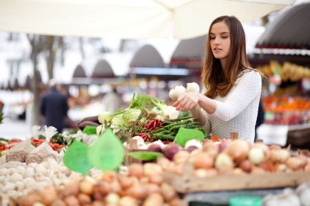 Young woman pointing to produce she wants to buy at farmers market Stock Photo - 19026291