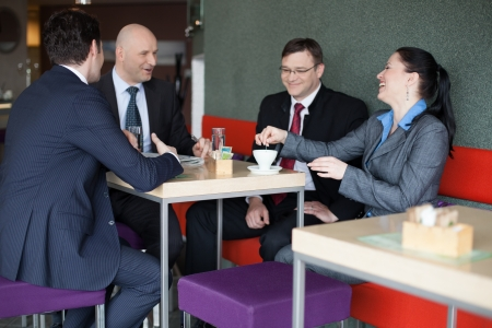 Business team having fun on coffee break photo