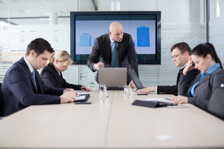 business disagreement: Manager yelling at his employees at the meeting  Company is in recession  Stock Photo