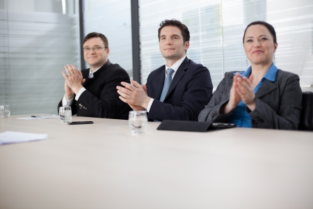 Business people applauding at the meeting   to boss photo