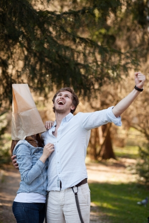 ugly woman: Young man is happy because he can finally take his ugly girlfriend outside Stock Photo