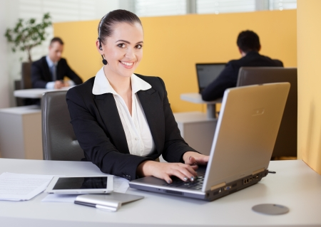 Friendly customer service employee working in the office Stock Photo - 19380086