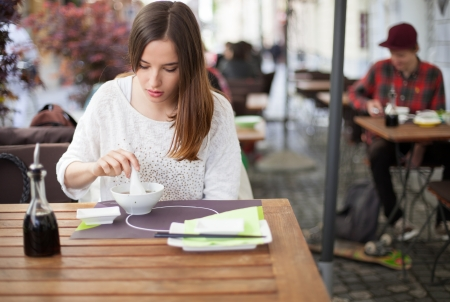 Young woman eating soup in an Asian restaurant Stock Photo - 19754661